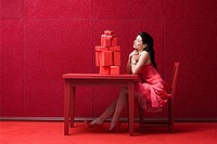 Woman in red room with gifts