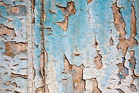 Peeling paint on a wooden wall