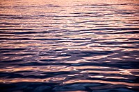 Ripples on the ocean at sunset