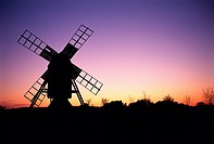 Windmill with nightsky in the background.