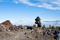 Mt. Adams Wilderness Washington State USA, Hiker walking through Avalanche Valley Camp