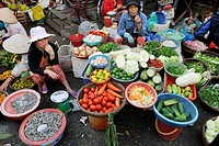 RM, licensed, no model release _ editorial only woman selling fresh vegetables at the farmers market of Hoi An, UNESCO World Heritage Site, Vietnam, A...