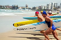 Lifesavers sprint for the water in a surfboard race competition at Cronulla Beach  Sydney, New South Wales, Australia