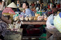Hoi An,Vietnam,Vendors selling at an open air market