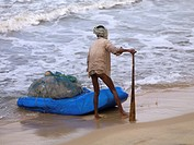 Arabian Sea,Kerala,India,Fisherman hauling his catch ashore