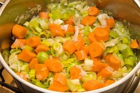 Carrots, leaks and onions browning as basis for vegetable soup