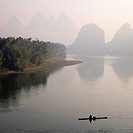 Li River, Yangshuo county, Guilin, Guangxi Province, China, lone boater