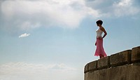 Woman stands on the edge