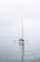 Family in a sailing boat on Lake Ammersee, bavaria, Germany