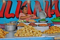 Mature woman preparing food at a snack, Pura Samun Tiga, Bali, Indonesia, Asia