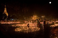 Buddhistic believers lighting candles at full moon, grounds of the Botataung Pagoda at night, Yangon, Rangoon, Myanmar, Burma