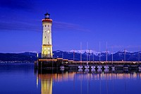 Lighthouse at harbour in the evening, snow covered Alps in the background, Lindau, Lake Constance, Baden Wurttemberg, Germany