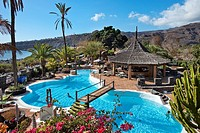 View over the swimming pool of Jardin Tecina Hotel in the sunlight, Playa de Santiago, La Gomera, Canary Islands, Spain, Europe