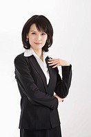 Businesswoman standing with hands on chest, Business People