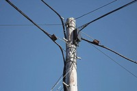 Telegraph pole with linking cables