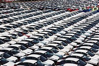 looking down close up on dockside storage of imported new cars awaiting distribution at the port of Paldiski, Tallinn, Estonia