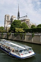 France, Paris 75  Notre Dame cathedral and tourist boat on the Seine river