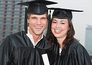 A young woman and young man graduating