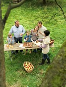 People eating applecake with basket