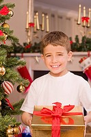 Boy holding Christmas gift