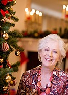 Woman standing near Christmas tree