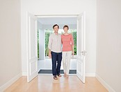 Smiling couple standing in doorway