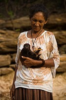 Woman with Monkey in the Lap, Santo Elias Community, Negro River, Novo Airão, Amazonas, Brazil