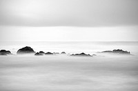 High contrast long exposure of rocks in sea