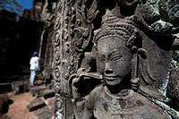 Tourist outside temple in ancient city of Angkor, Angkor Wat, Siem Reap, Cambodia
