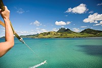 Cropped view of person parasailing with view of Lion Mountain, Mauritius