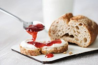 Whole wheat bread with cream cheese and jam