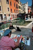 Woman painting in Venice