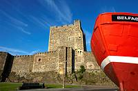Carrickfergus Castle with the front of a fishing trawler in the foreground, County Antrim