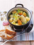 Potatoes and root vegetables in ´sour´ stock with baguette