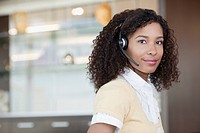 Businesswoman using headset microphone