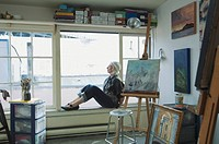Artist sitting in studio