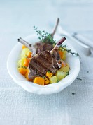 Grilled lamb chops on pumpkin and potatoes