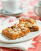 Two Almond Peach Squares on a Plate