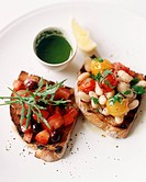 Two Pieces of Bruschetta, White Bean and Tomato and Tomato and Olive