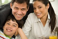 Boy with his parents sitting at a breakfast table