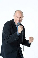 Businessman shouting into a microphone