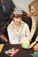 Portrait of a businesswoman celebrating her birthday with her colleagues