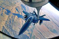 An F-15E Strike Eagle refuels over the mountains of Afghanistan during its flight in support of Operation Mountain Lion on Wednesday, April 12, 2006  ...
