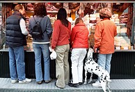Shopping with a Dalmation dog in Bolzano, Alto Adige, Italy