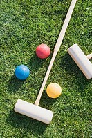 Close_up of two polo mallets with balls