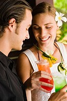 Close_up of a couple enjoying cocktail, Papeete, Tahiti, French Polynesia