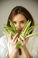 Woman holding green beans