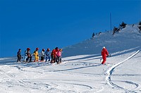 France, Isere, Belledonne Massif, Chamrousse, ski resort, group of children taking skiing lessons