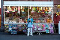 woman standing in front of toy stall during carnaval time in santa cruz de tenerife canary islands spain