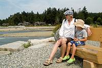 woman with five year old boy on bench at Roberts Creek, BC, Canada